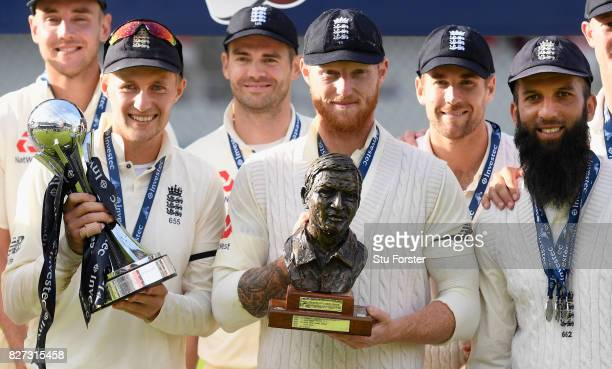 England captain Joe Root Ben Stokes and Moeen Ali pictured with the silverware after day four of the 4th Investec Test match between England and...