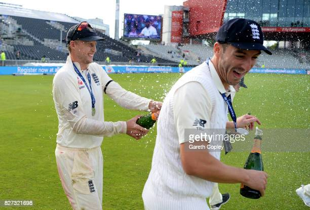 England captain Joe Root celebrates with Toby RolandJones after winning the Investec Test series between England and South Africa at Old Trafford on...
