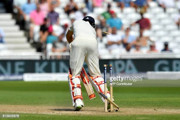 England captain Joe Root is bowled out by South Africa's Chris Morris for 8 runs on the fourth day of the second Test match between England and South...