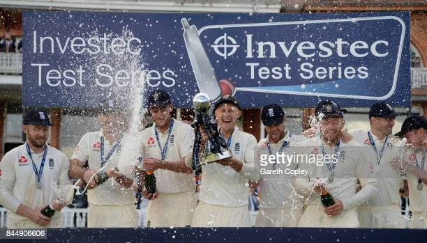 England captain Joe Root lifts the series trophy after winning the 3rd Investec Test match between England and the West Indies at Lord's Cricket...