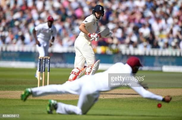 England captain Joe Root looks to hits past Kyle Hope of the West Indies during the 1st Investec Test match between England and West Indies at...