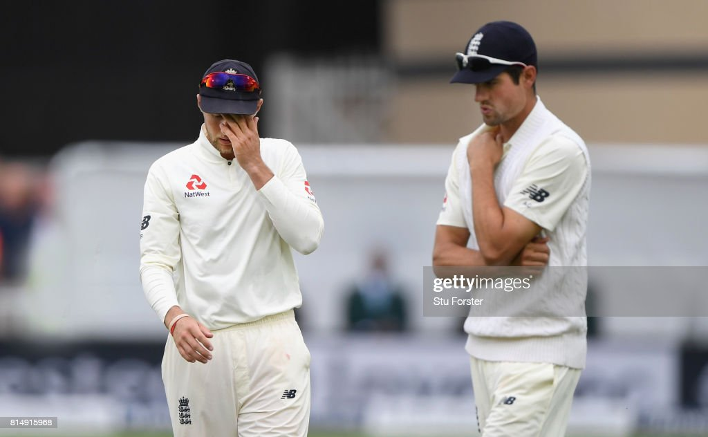 England captain Joe Root (l) reacts as Alastair Cook looks on during day two of the 2nd Investec Test match between England and South Africa at Trent Bridge on July 15, 2017 in Nottingham, England.