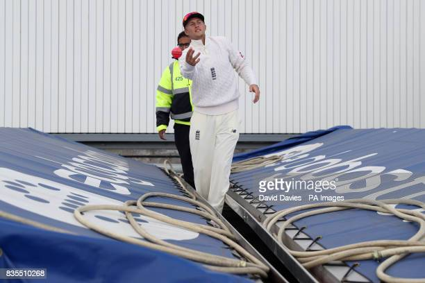 England captain Joe Root retrieves the ball from under the covers during day three of the First Investec Test match at Edgbaston Birmingham