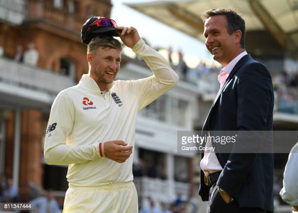 England captain Joe Root speaks with former captain Michael Vaughan after winning the 1st Investec Test between England and South Africa at Lord's...