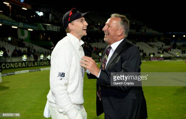 England captain Joe Root speaks with Sir Ian Botham after winning the 1st Investec Test between England and the West Indies at Edgbaston on August 19...