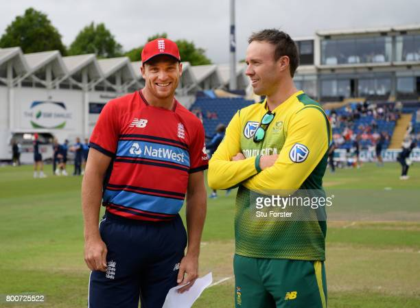 England captain Jos Buttler shares a joke with South Africa captain AB de Villiers before the 3rd NatWest T20 International between England and South...