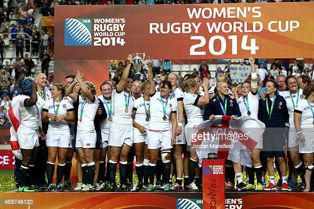 England Captain Katy Mclean and Sarah Hunter hold the trophy after England win the IRB Women's Rugby World Cup 2014 Final between England and Canada...
