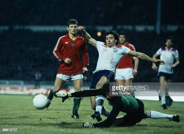 England captain Kevin Keegan is beaten to the ball by Hungarian goalkeeper Ferenc Meszaros with Sandor Sallai looking on during the World Cup...