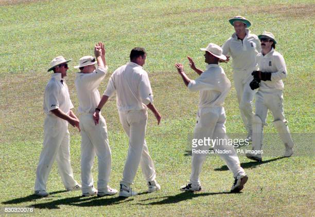 England captain Michael Atherton runs to congratulate Angus Fraser after dismissing Stuart Williams during the 2nd Test between England and West...