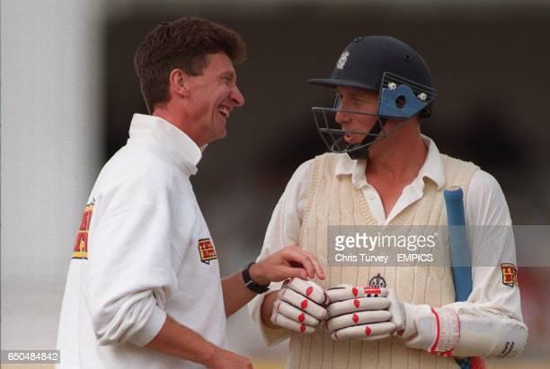 England captain Michael Atherton shares a joke with physiotherapist Dave Roberts