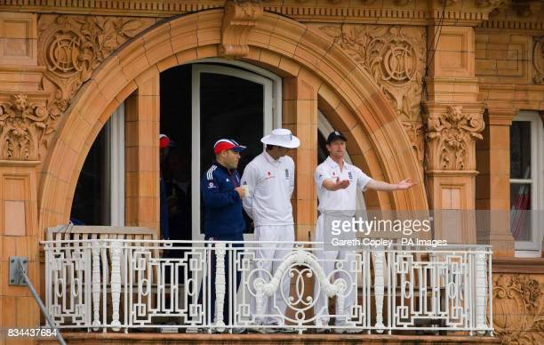 England captain Michael Vaughan and Paul Collingwood wait on the balcony during the First npower Test Match at Lord's London
