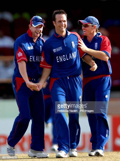England captain Michael Vaughan celebrates taking a wicket with Paul Collingwood and Ian Bell during the ICC Cricket World Cup Super Eights match at...