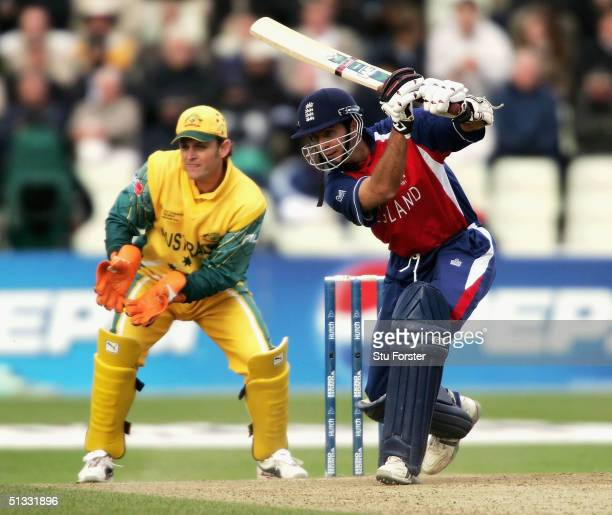 England captain Michael Vaughan drives a ball through the off side watched by Australian wicketkeeper Adam Gilchrist during the ICC Champions Trophy...