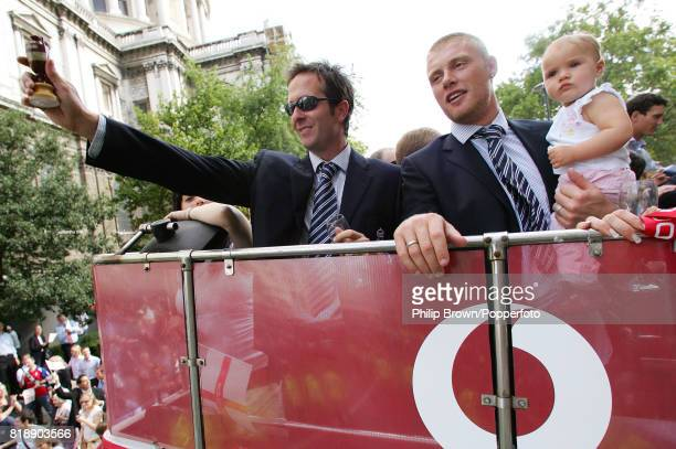 England captain Michael Vaughan shows off a a replica of the Ashes with teammate Andrew Flintoff holding his daughter Holly aboard the parade bus on...