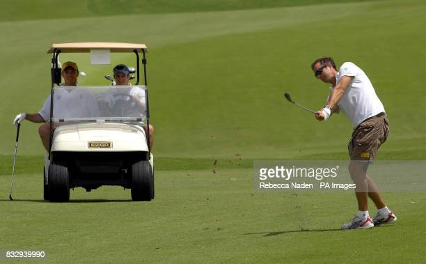 England captain Michael Vaughan the host plays his second shot on the 2nd hole watched by Paul Nixon and Andrew Strauss at Royal Westmoreland Golf...
