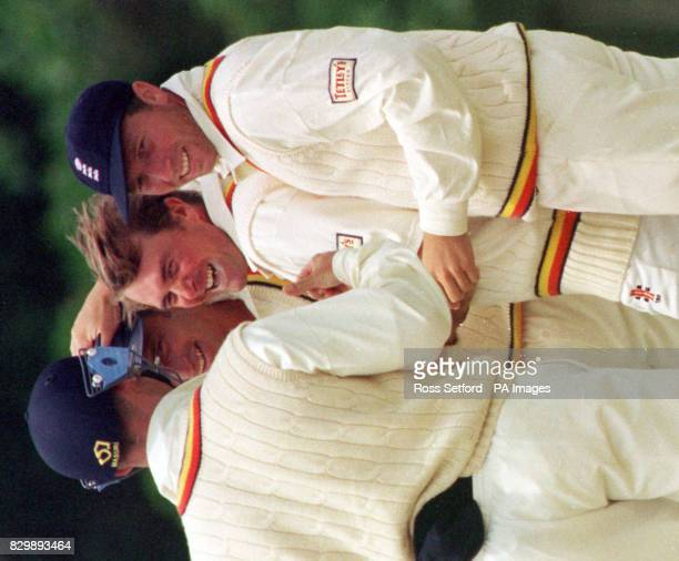 England captain Mike Atherton congratulates spin bowler Phil Tufnell after he took another Kiwi wicket on his way to a five wicket haul as England...