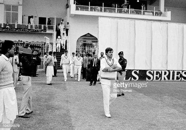 England captain Mike Gatting leads out his team at the start of the fourth day of the Pakistan v England 2nd Test Match played at the Iqbal Stadium...