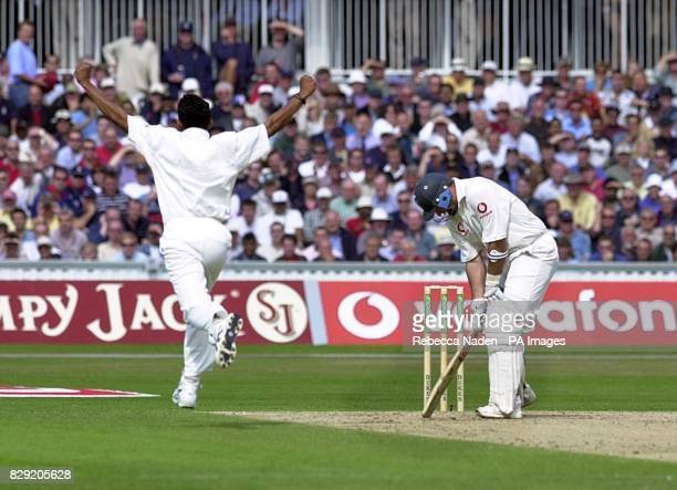 England captain Nasser Hussain is dismissed for 10 runs as he's caught by India's VVS Laxman off the bowling of Sanjay Bangar during the second day...