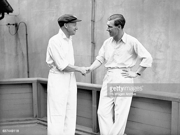 England captain Norman Yardley congratulates his opposite number Australia's Don Bradman on his unbeaten 173 which helped Australia set a new test...