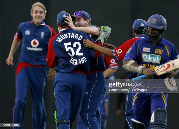 England captain Paul Collingwood congrates wicketkeeper Phil Mustard after catching out Sri Lanka's Kumar Sangakkara for 9 runs during the Third One...