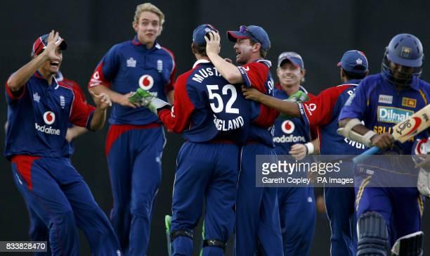 England captain Paul Collingwood congratulates wicketkeeper Phil Mustard after catching out Sri Lanka's Kumar Sangakkara for 9 runs during the Third...