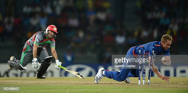 England captain Stuart Broad runs out Karim Sadiq of Afghanistan during the ICC World Twenty20 2012 Group A match between England and Afghanistan at...