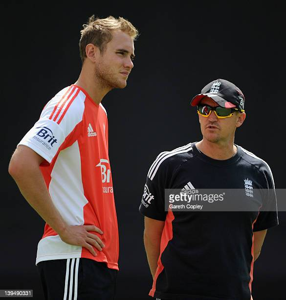 England captain Stuart Broad speaks with coach Andy Flower during a nets session at Dubai International Stadium on February 22 2012 in Dubai United...