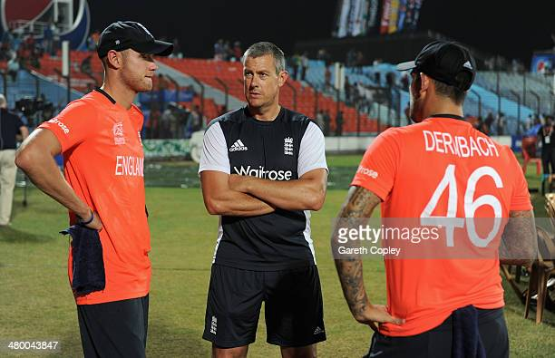 England captain Stuart Broad speaks with coach Ashley Giles and Jade Dernbach as they wait for play to restart during the ICC World Twenty20...