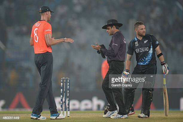 England captain Stuart Broad speaks with umpire Aleem Dar and Brendon McCullum of New Zealand before the game is stopped for rain during the ICC...