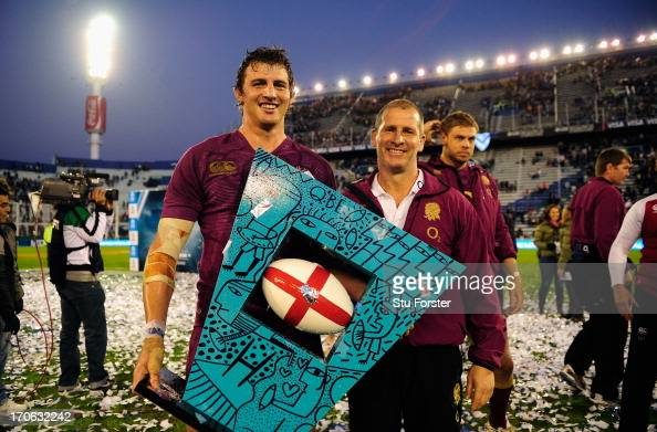 England captain Tom Wood and coach Stuart Lancaster with the trophy after the second test match between Argentina and England at the Stadium Velez...