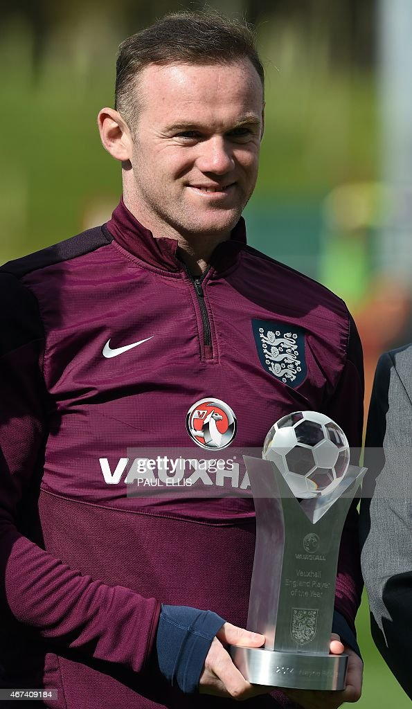 England captain Wayne Rooney receives the Vauxhall player of the year award before a training session at St George's Park near BurtononTrent central...