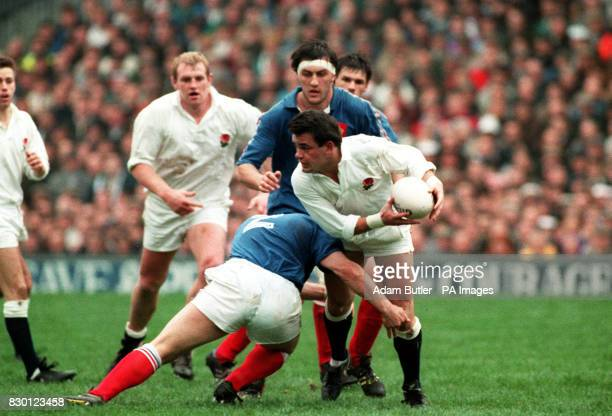 England captain Will Carling is put under pressure as teammate Dean Richards runs in to provide support during the international rugby union match...