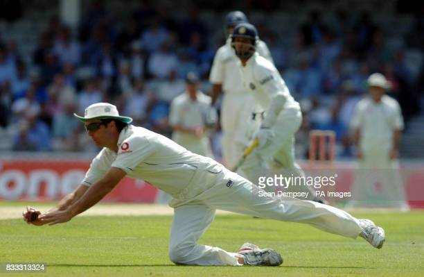 England captian Michael Vaughan makes a stop from Dinesh Karthik during the first day of theThird npower Test match at The Brit Oval Kennington London
