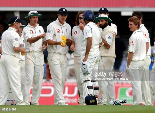 England captian Michael Vaughan offers India's Sourav Ganguly a Jelly sweet during the drinks break in the first day of theThird npower Test match at...