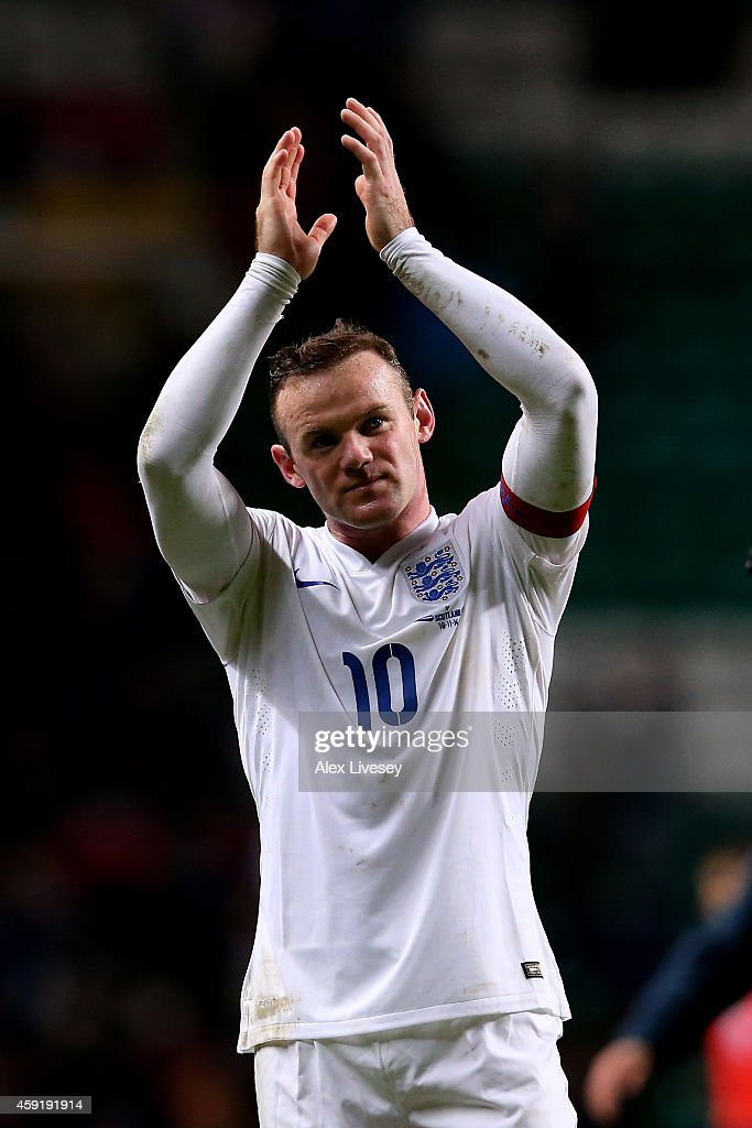 England captian <a gi-track='captionPersonalityLinkClicked' href=/galleries/search?phrase=Wayne+Rooney&family=editorial&specificpeople=157598 ng-click='$event.stopPropagation()'>Wayne Rooney</a> applauds the travelling fans following histeam's victory during the International Friendly match between Scotland and England at Celtic Park Stadium on November 18, 2014 in Glasgow, Scotland.