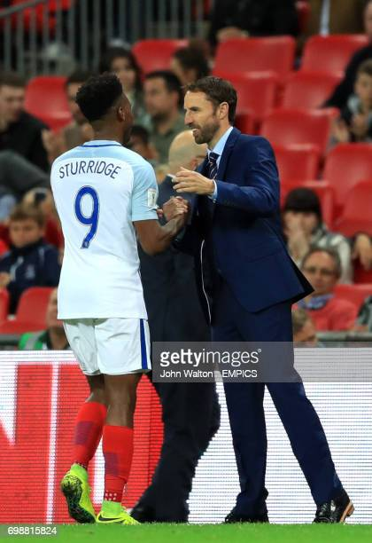 England caretaker manager Gareth Southgate shakes the hand of England's Daniel Sturridge as he comes off