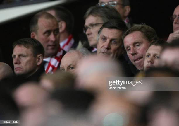 England caretaker manager Stuart Pearce and Tottenham Hotspur manager Harry Redknapp watch from the directors' box during the UEFA Europa League...