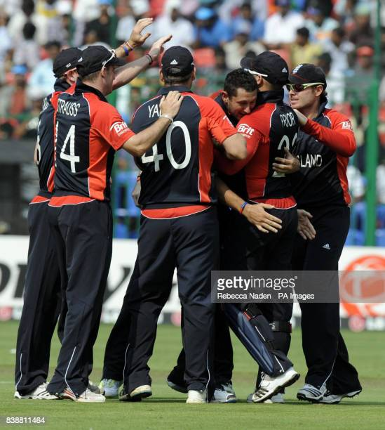 England celebrate after Indian batsman Virender Sehwag is dismissed by Tim Bresnan during the ICC Cricket World Cup match at Chinnaswamy Stadium...