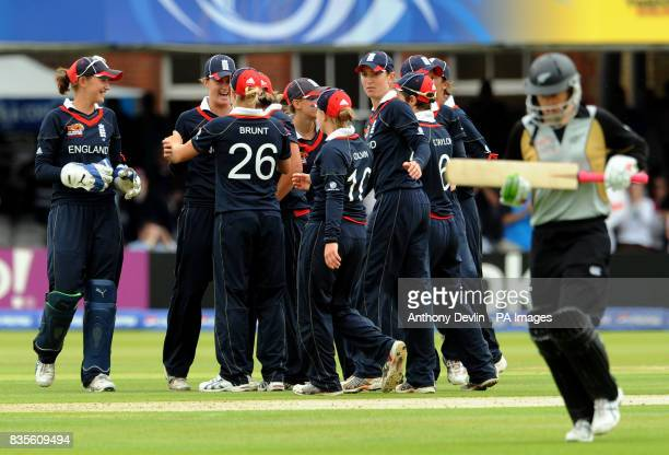 England celebrate after New Zealand final batsman Sophie Devine is run out by Sarah Taylor during the Final of the Womens ICC World Twenty20 at Lords...