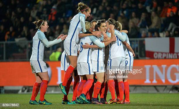 England celebrate after scoring their first goalduring the international friendly match between Netherlands Women and England Women at Koning Willem...