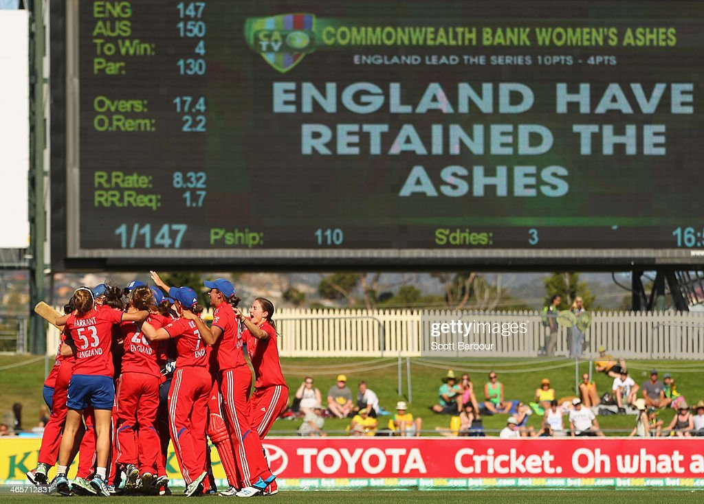 England celebrate after winning the match and retaining the Ashes during game one of the International Twenty20 series between Australia and England at Blundstone Arena on January 29, 2014 in Hobart, Australia.
