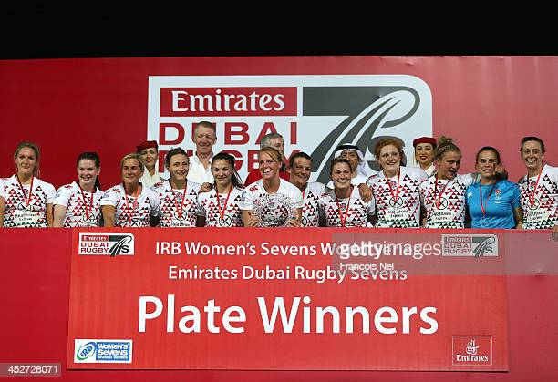 England celebrate after winning the Women's Plate final at the Dubai Sevens the second round of the HSBC Sevens World Series at The Sevens stadium on...