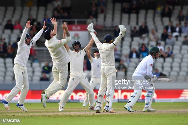 England celebrate as South Africa's Duanne Olivier is caught by England's Ben Stokes as England win the test match during day four of the Fourth...