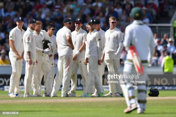 England celebrate as South Africa's Heino Kuhn leaves the field after losing his wicket for 24 runs during day two of the Fourth Investec Test at...