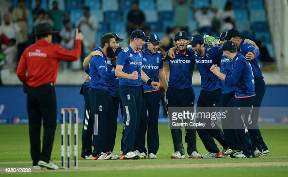 England celebrate taking the final wicket to win the 4th One Day International between Pakistan and England at Dubai Cricket Stadium on November 20...