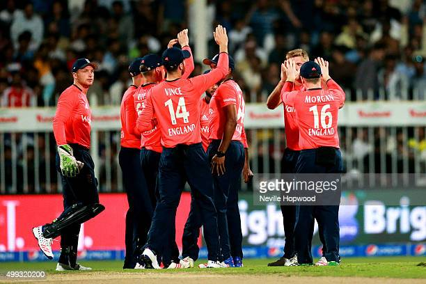 England celebrate taking the wicket of Shahid Afridi during the 3rd International T20 match between Pakistan and England at Sharjah Cricket Stadium...