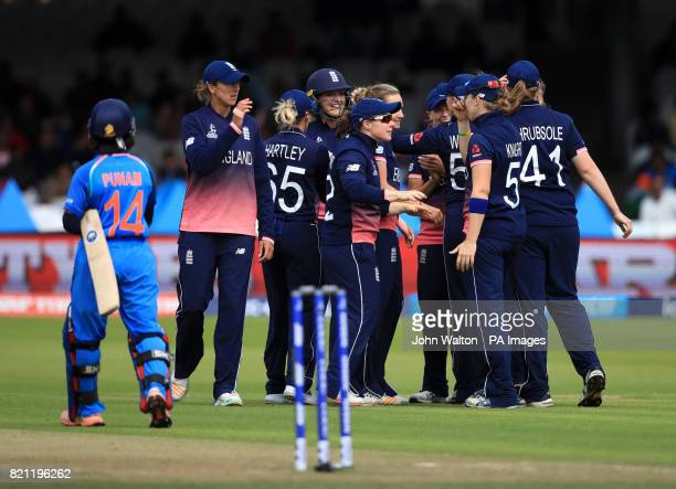 England celebrate the wicket of India's Mithali Raj during the ICC Women's World Cup Final at Lord's London
