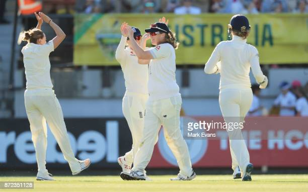England celebrate the wicket of Nicole Bolton caught by Anya Shrubsole bowled by Laura Marsh during day two of the Women's Test match between...
