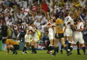 England celebrate their win at fulltime as Jeremy Paul of Australia looks on after the Rugby World Cup Final match between Australia and England at...