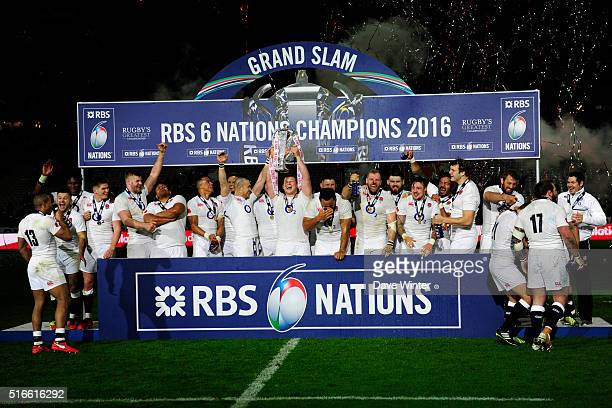 England celebrate winning the Grand Slam after the RBS Six Nations match between France and England at Stade de France on March 19 2016 in Paris...